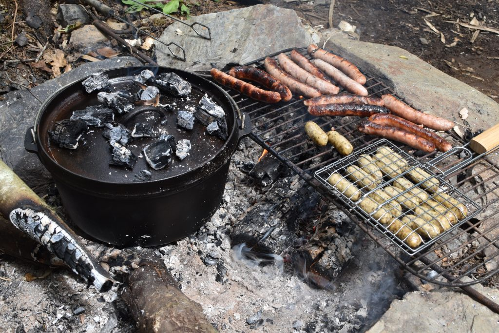 Bannock bread cooking in the Dutch Oven to accompany sausages (with vegan option)